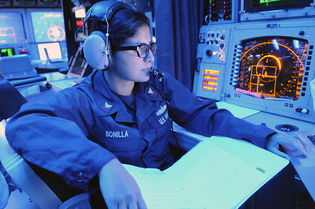 Standing the surface warfare coordinator watch in the combat information center (CIC) aboard the cruiser USS Cowpens.